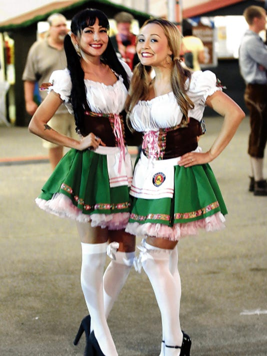 """The Paulaner Oktoberfest girls are all smiles after the """"tapping"""" of the first keg at the El Paso County Coliseum during the first annual Authentic El Paso Oktoberfest."""