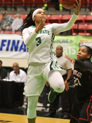 Fort Myers guard Destanni Henderson goes up for a basket against Northeast during the FHSAA Girls 6A basketball finals Saturday February 20, 2016 in Lakeland, Florida. Fort Myers won the title 60-45. Photos by Cindy Skop 2016