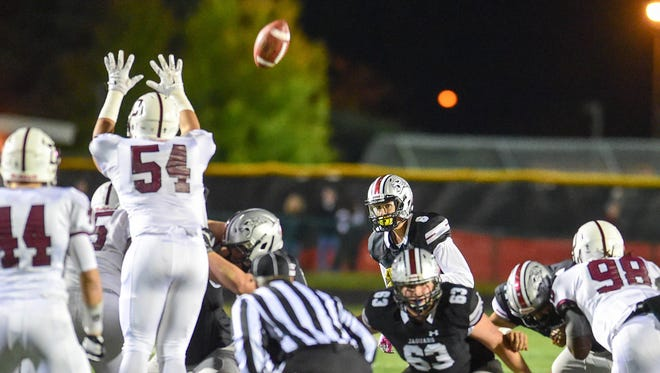 Ankeny Centennial kicker Jake Pinegar (8) kicks a 50-yard field goal in the first half on Friday, Oct. 14, 2016, during a football game between the Dowling Maroons and the Ankeny Centennial Jaguars at Ankeny Stadium.