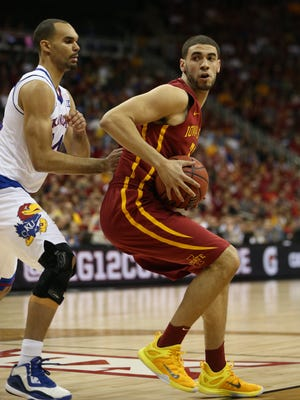 Iowa State's Georges Niang drives on Perry Ellis of Kansas during the Big 12 Championship title game between Iowa State and Kansas on Saturday, March 14, 2015, outside the Sprint Center in Kansas City, Missouri.
