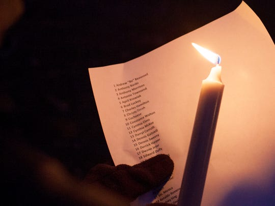 The list of homeless people who died in 2014 was read aloud at the Homeless Memorial Day candle light vigil Friday, December 19, 2014.
