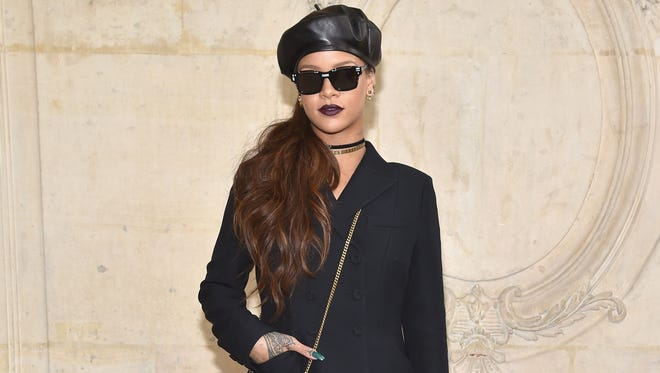 Rihanna attended the Christian Dior show on March 3, 2017 in Paris in a dark ensemble with a purse to match.