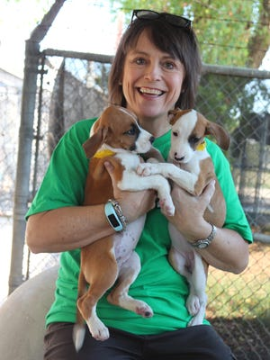 Ellen Silk Hicks with two of her charges at the Humane Society Adoption Center in Monroe.