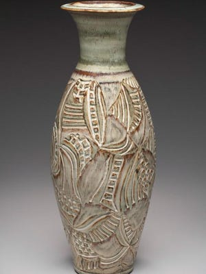 """Carved pot by Door County Potters' Guild members Judy and Thor Thoreson of Gills Rock Pottery, part of the """"Beyond Scratching the Surface: Today's Ceramic Decoration"""" exhibit opening Aug. 18 at the Peninsula School of Art."""