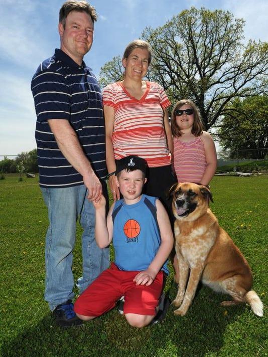 FON 052414 service dog haack family.jpg
