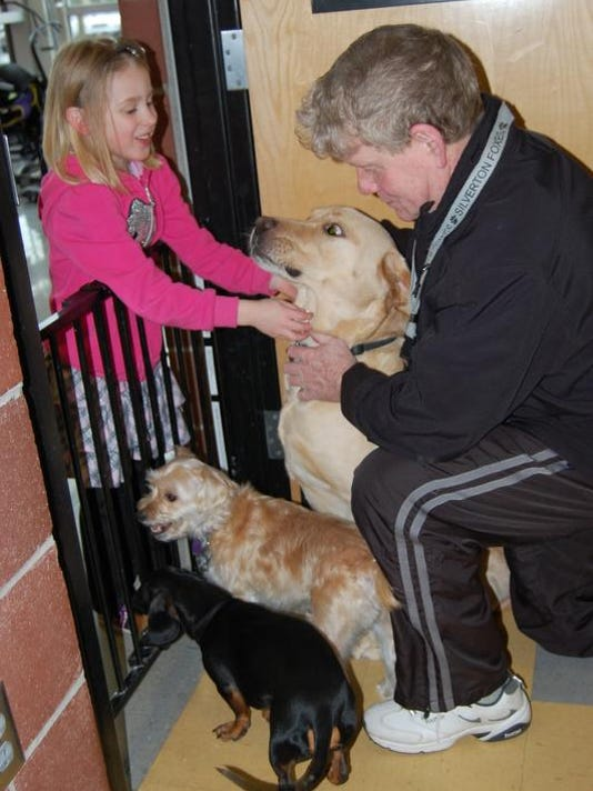 -Griffin with dogs.jpg_20140214.jpg