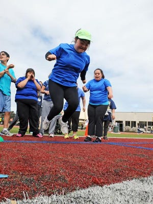 Mary Lu Hernandez, 21, a student at the Salinas Transition Program, competes in the long jump.