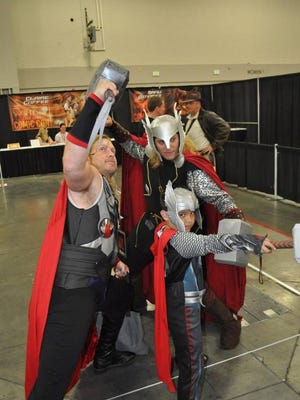A group of guys dressed as Thor pose at the Salt Lake Comic Con 2013.