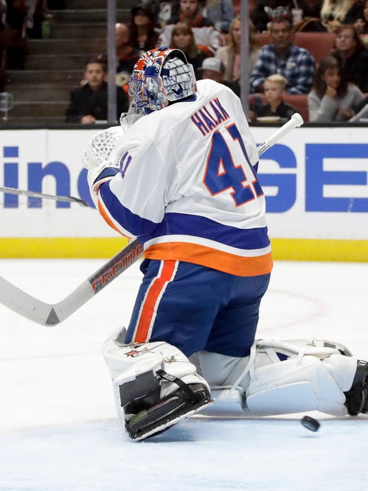 New York Islanders goalie Jaroslav Halak can't stop a goal by Anaheim Ducks' Rickard Rakell during the second period of an NHL hockey game in Anaheim, Calif., Wednesday, Oct. 11, 2017. (AP Photo/Chris Carlson)