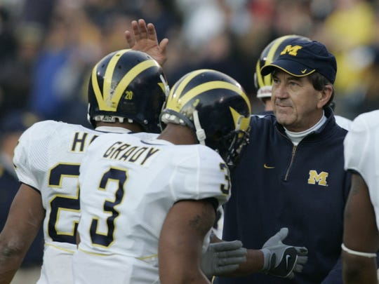 Michigan head coach Lloyd Carr cheers on Mike Hart after Hart scored a touchdown in the 1st quarter between Michigan and Ohio State on Saturday, Nov. 18, 2006 in Columbus, Ohio.