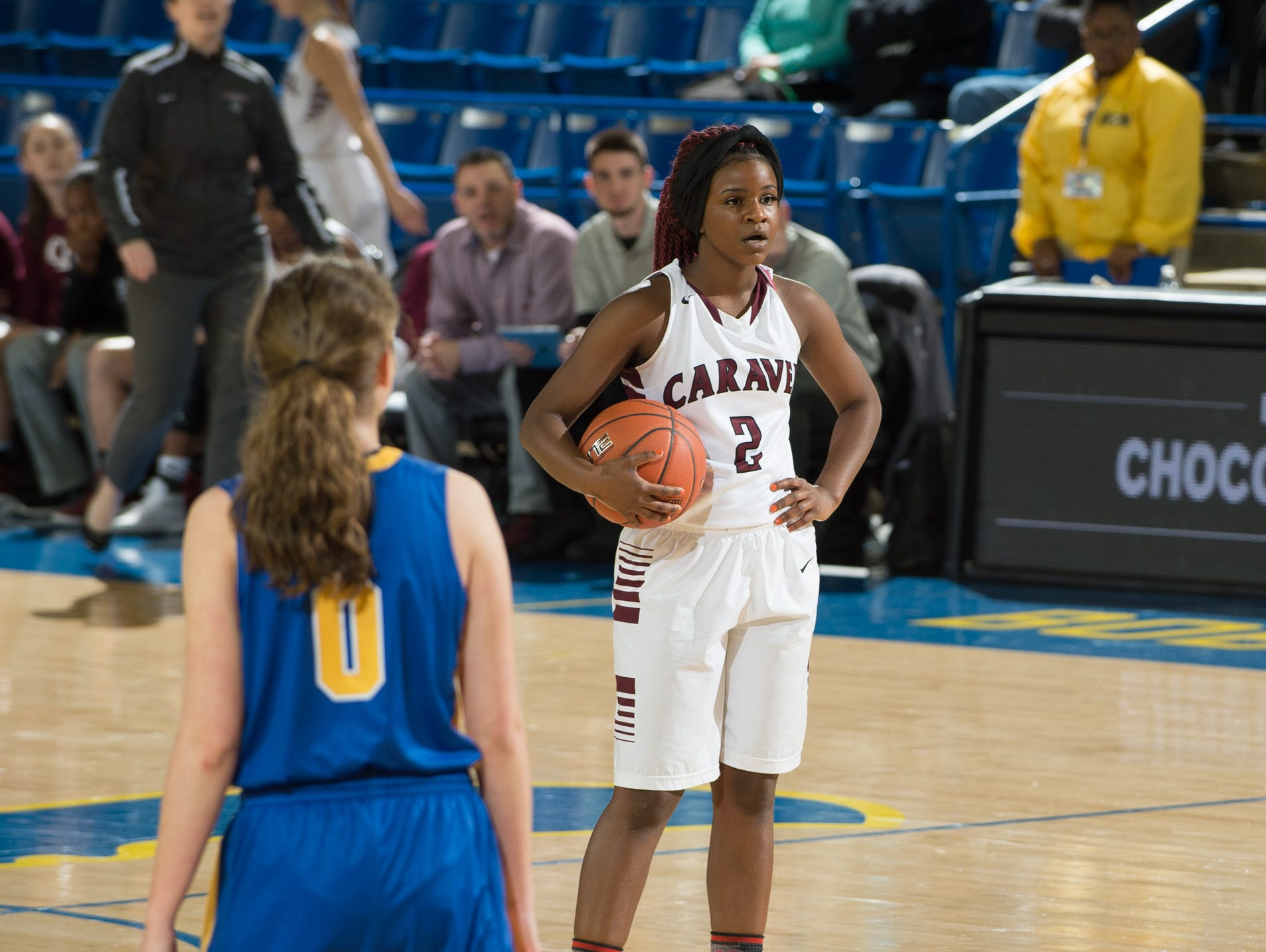 Caravel's Maia Bryson (2) holds on to the ball running the clock in the quarterfinals of DIAA Girls Basketball Tournament at the University of Delaware against A.I. duPont.