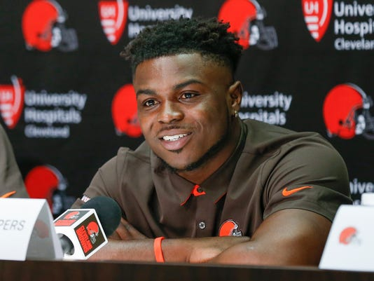 FILE - In this April 28, 2017, file photo, Cleveland Browns' Jabrill Peppers answers a question during a news conference at the NFL team's training facility in Berea, Ohio. Before taking the field and covering a wide receiver, Browns rookie Jabrill Peppers defended his reputation. Under scrutiny after being placed in the NFL's drug program for a diluted urine sample taken at the scouting combine, Peppers said that he has no history using illegal recreational drugs and that Cleveland doesn't have to worry about him getting into any trouble. Peppers, drafted in the first round by the Browns last month, addressed his recent failed test on Friday, May 12, 2017, as Cleveland's rookies began their three-day minicamp. (AP Photo/Ron Schwane, File)