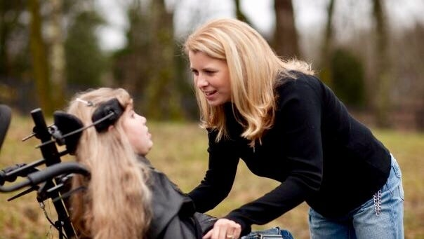 Rachel McAuley talks to her daughter, Mary, who had cerebral palsy.
