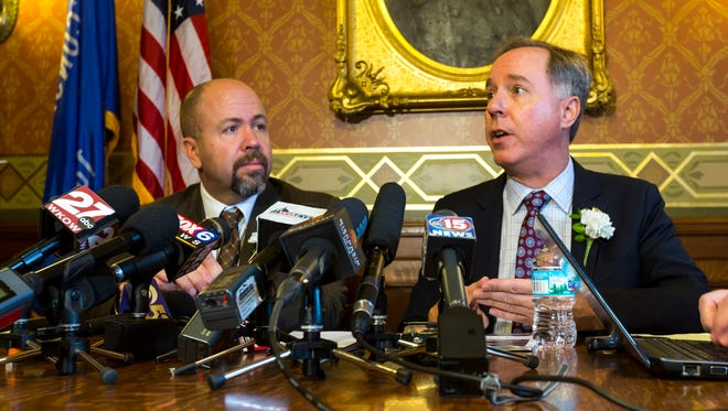 Wisconsin Majority Leader Jim Steineke (left) (R-Kaukauna) and Wisconsin Assembly Speaker Robin Voss (R-Rochester) talk during a news conference at the state Capitol in Madison.
