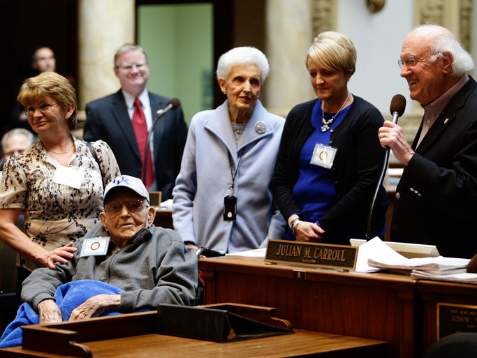 The senate honors Harvey Gaines, left, on his 101st birthday, Monday, Mar. 24, 2014 at the Capitol in Frankfort.  Celebrating the occasion with him are primary caregiver Brenda Bryant, left, daughter Wilma Gaines, granddaughter Meribeth Gaines, and Sen. Julian Carroll D-Frankfort.  By Jonathan Palmer/Special to the Courier-Journal