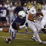 Nevada's Salesa Faraimo tackles UC Davis' Manusamoa Luuga for a loss during their football game at Mackay Stadium last Thursday.