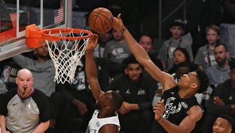 Feb 18, 2018; Los Angeles, CA, USA; Team Stephen forward Giannis Antetokounmpo of the Milwaukee Bucks (34) defends against Team LeBron guard Kemba Walker of the Charlotte Hornets (15) in the first half during the 2018 NBA All Star game at Staples Center. Mandatory Credit: Richard Mackson-USA TODAY Sports