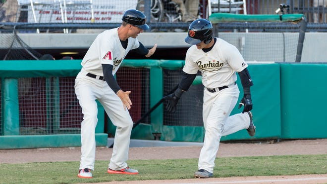 Visalia Rawhide catcher Daulton Varsho, right, celebrates after hitting a home run earlier this season.