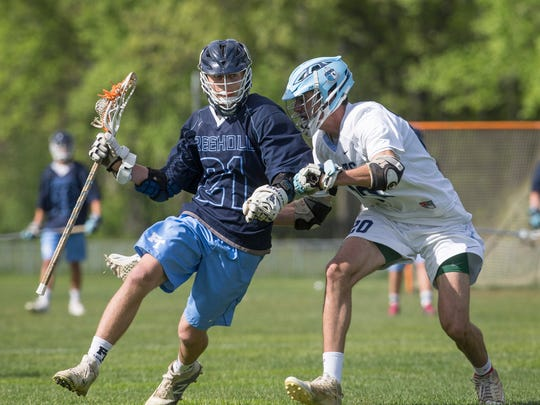 Freehold Township's Matthew Kondrup tries to work in against CBA's Jack Koury during Freehold Township Boys Lacrosse vs Christian Brothers Academy in Middletown, NJ on 5/9/17. f