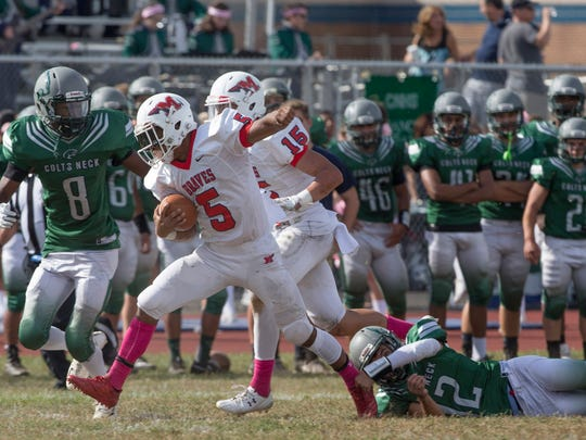 Manalapan's Naim Mayfield runs through the line for