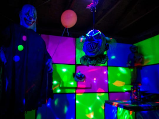 """A clown room in """"Nightmare on Eastbrooke,"""" neighborhood-run haunted house in Shawn Smith's garage that collects canned goods as an admittance fee, is seen on Tuesday, Oct. 24, 2017."""