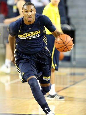Michigan guard Zak Irvin runs a fast break during practice Oct. 24, 2013, at the Crisler Center in Ann Arbor.
