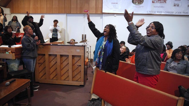 The Akoma Gospel Choir rehearses at the First Church of God on Clarissa St. Singing lead at left is Carmen Allen of Brighton. Standing and singing are Pat Starks of WIlliamson and Esther Pinkston of Greece. The choir is celebrating its twentieth anniversary this year.