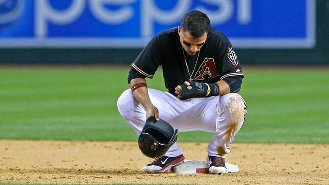 April 26, 2014 - Diamondbacks third baseman Martin Prado reacts during a review of his attempted stolen base against the Phillies in the ninth inning at Chase Field.