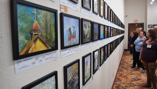 In this file photo, patrons and visitors check out the opening of the Mystery Art Fest exhibit in 2017 at the Kemp Center for the Arts.