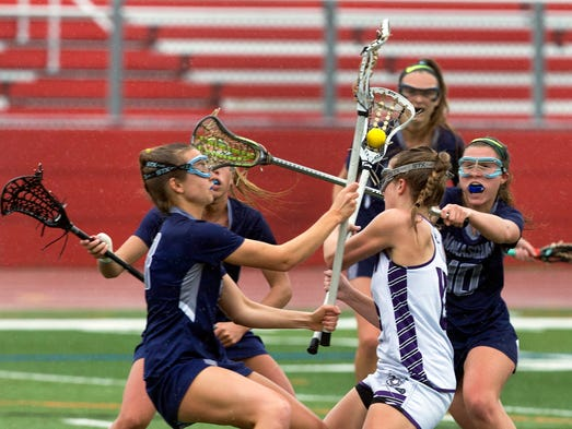 Rumson's Maggie Jennings gets swarmed as she tries