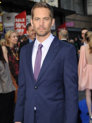 """Paul Walker attends the """"Fast & Furious 6"""" World Premiere at The Empire, Leicester Square on May 7, 2013 in London, England."""