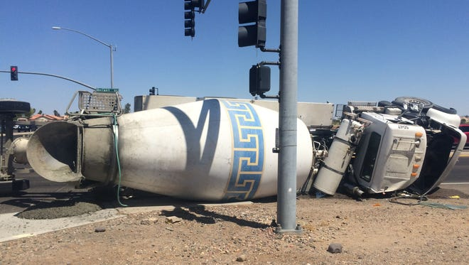 A cement truck overturned in Avondale shortly after 1:30 p.m. when the driver attempted a U-turn. No injuries were reported.