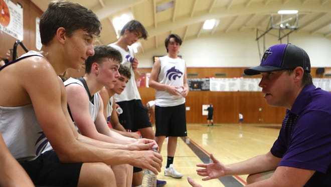 Jordan Freilich, right, coaches members of the Shasta High basketball team Thursday at a summer league scrimmage at Corning High School. Freilich will be taking over the head coaching job next season.