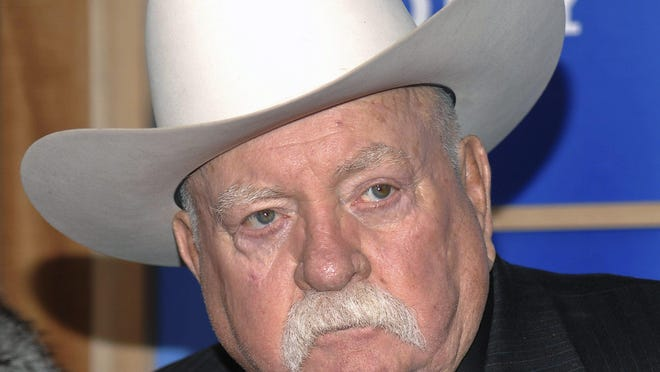 """In this Monday, Dec. 14, 2009 file photo, Actor Wilford Brimley attends the premiere of 'Did You Hear About The Morgans' at the Ziegfeld Theater in New York. Wilford Brimley, who worked his way up from stunt performer to star of film such as """"Cocoon"""" and """"The Natural,"""" has died. He was 85."""
