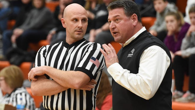 Ankeny Centennial coach Bob Fontana disagrees with a call on Friday, Feb. 24, 2017, during a substate basketball game between the Valley Tigers and the Ankeny Centennial Jaguars at Valley High School.