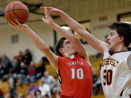 Yankton's Jack Wolfgram shoots over Roosevelt's James Lauer during their game on Tuesday, Jan. 31, 2017.