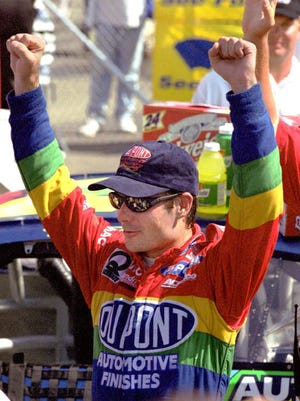 Jeff Gordon celebrates after winning the Bud at The Glen at Watkins Glen International in 1998.