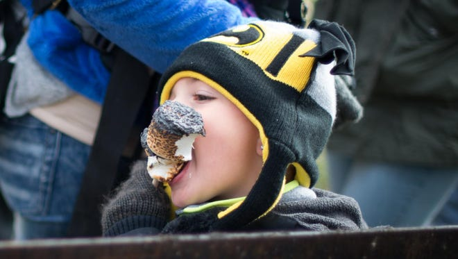 Skyler Ackerman, 3 1/2, of Irondequoit digs into his roasted marshmallows during the  third annual Winterfest, held at the Irondequoit Town Hall on Saturday, Jan. 28, 2017.