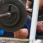 Ryan Hammer presses his weight during the YMCA's Bench Press Competition Saturday afternoon