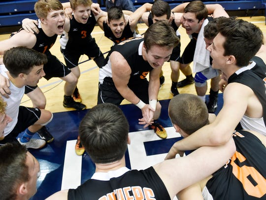 Central York's Drew Anderson leads the boys' volleyball team in a cheer after winning the PIAA Class 3A championship June 10, 2017, at Penn State. Central York defeated North Allegheny, 3-1, to win the Panthers' seventh boys' volleyball title.