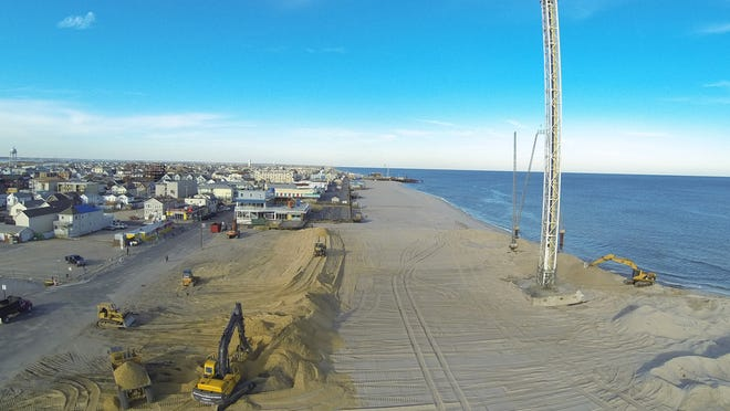 Seaside Park has approved the use of beach buggies where Funtown Pier once stood. New sand dunes are pushed into place along Ocean Avenue in Seaside Park in this 2013 photo.