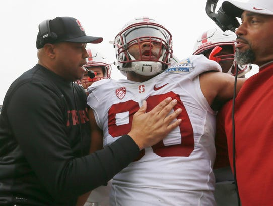 Stanford coach David Shaw congratulated defensive lineman