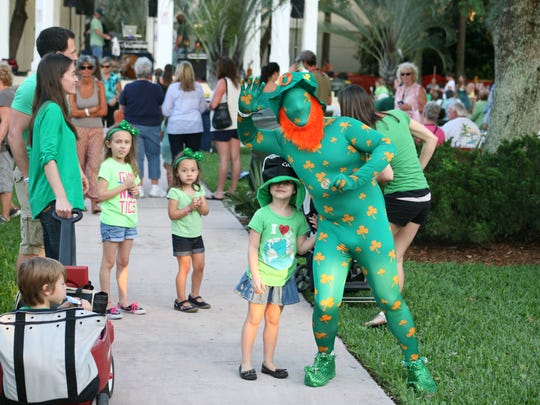 Guests enjoy the festivities at the Shamrock Fest in downtown Stuart.