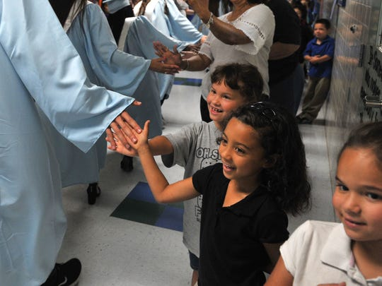 Students and teachers at Burgess Elementary school gave Hirschi Graduating Seniors High School students a warm welcome Wednesday morning during students walkthrough.