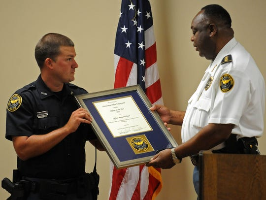 Hattiesburg Police Chief Frazier Bolton, right, presents