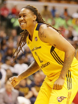 The Indiana Fever's Erlana Larkins reacts to a referees call, Saturday May 14th, 2016. The Indiana Fever Played the Dallas Wings in their season opener at Bankers Life Fieldhouse.