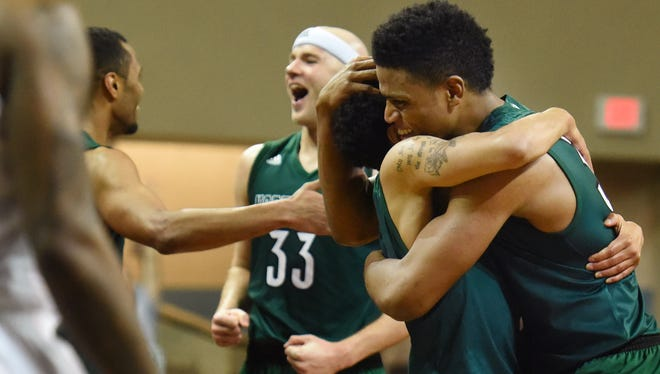 Northwest Missouri State's Justin Pitts (1) embraces D'Vante Mosby (right) while they celebrate their victory over Fairmount State during the NCAA 2017 Division II Men's Elite Eight championship at the Sanford Pentagon in Sioux Falls, S.D. on Saturday, March 25, 2017.