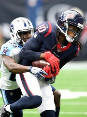 Texans wide receiver DeAndre Hopkins (10) makes a catch over Titans cornerback Adoree' Jackson (25) during the first quarter at NRG Stadium  Sunday, Oct. 1, 2017 in Houston, Texas.