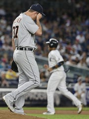 Detroit Tigers starting pitcher Mike Pelfrey reacts after walking New York Yankees' Chase Headley during the fourth inning to load the bases during the fourth inning of a baseball game Friday, June 10, 2016, in New York. The Yankees won 4-0. (AP Photo/Frank Franklin II)