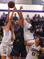 McQueen's Alisi Peaua (50) fights for a rebound while